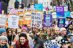 © Licensed to London News Pictures. 04/03/2018. London, UK. People join March 4 Women in central London, ahead of International Women's Day, to mark the centenary of the Representation of the People's Act 1918 by retracing the steps of the Suffragettes from Parliament to Trafalgar Square. Photo credit: Rob Pinney/LNP