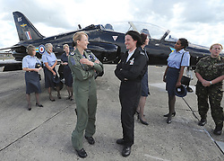 © under license to London News Pictures. DUXFORD, UK  12/05/2011. Flight Lieutenant Juliette Fleming (R wearing dark jumpsuit) from RAF 208 Squadron joins her colleges with her Hawk aircraft.  She has seen active service in Iraq and Afghanistan and is now in her first year with the RAF display team. Female RAF personnel at The launch of the 2011 air show season at Imperial War Museum Duxford. The air show celebrates women in the development of aviation. Photo credit should read Stephen Simpson/LNP.