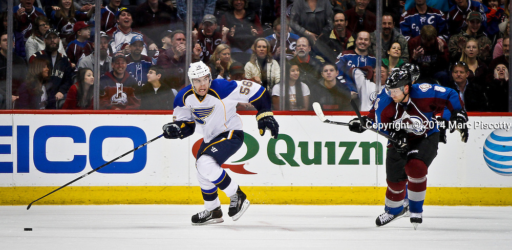 SHOT 3/8/14 4:29:27 PM - The St. Louis Blues Magnus Paajarvi #56 chases after a loose puck in front of the Colorado Avalanche's Jan Hejda #8 during their regular season Western Conference game at the Pepsi Center in Denver, Co. The Blues won the game 2-1.<br /> (Photo by Marc Piscotty / &copy; 2014)