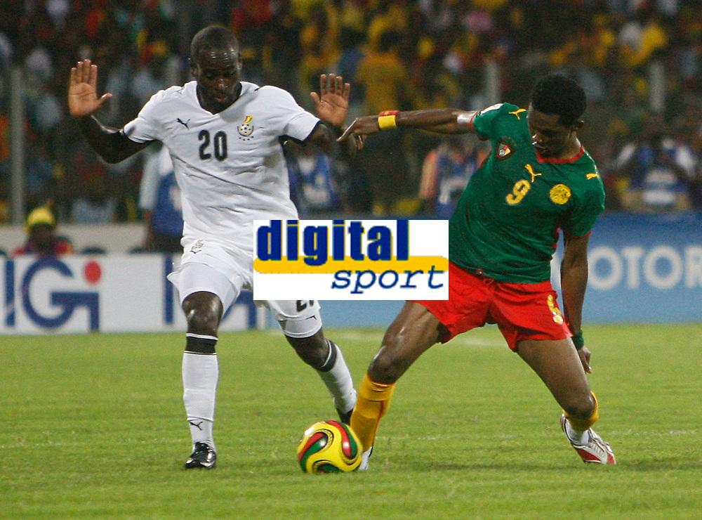 Photo: Steve Bond/Richard Lane Photography.<br />Ghana v Cameroon. Africa Cup of Nations. 07/02/2008. Samuel Eto'o (R) goes for the ball. Quincy Owusu-Abeyie (L) looks for a foul