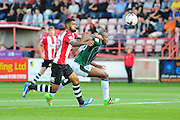 Luke Croll (29) of Exeter City battles with Paul-Arnold Garita (26) of Plymouth Argyle during the EFL Sky Bet League 2 match between Exeter City and Plymouth Argyle at St James' Park, Exeter, England on 17 September 2016. Photo by Graham Hunt.