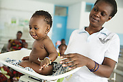 A girl is weighed at the Koumassi General Hospital in Abidjan, Cote d'Ivoire on Friday July 19, 2013.