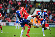 Romaine Sawyers of Walsall FC holds off Sam Morsy of Wigan Athletic during the Sky Bet League 1 match between Walsall and Wigan Athletic at the Banks's Stadium, Walsall, England on 20 February 2016. Photo by Mike Sheridan.