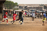 One Direction play football with boys who live in the Agbogbloshie slum, Accra