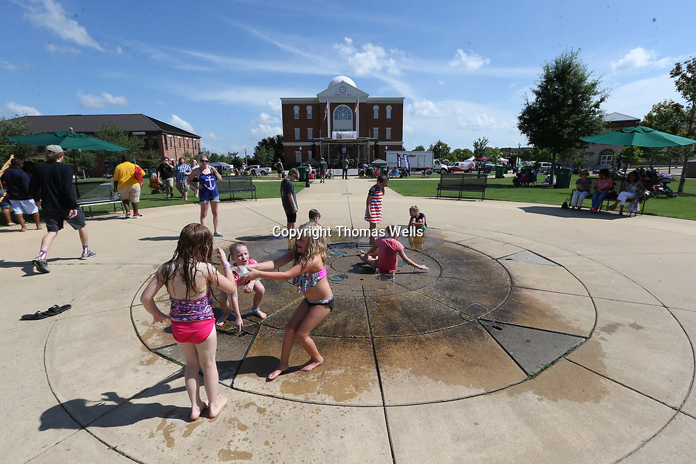 Children play in the fountain at Fairpark as the July 4th Picnic at Fairpark gets started Tuesday afternoon.