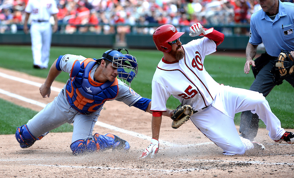 Aug 7, 2014; Washington, DC, USA; Washington Nationals first baseman Adam LaRoche (25) slides in safe past New York Mets catcher Anthony Recker (20) scoring his second run of the game off an Ian Desmond hit at Nationals Park.  Mandatory Credit: H.Darr Beiser-USA TODAY Sports ORG XMIT: USATSI-168716 ORIG FILE ID:  20140807_mta_bei_315.JPG