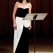 "February 18, 2012 - New York, NY : Soprano.Wonjung Kim performs the world premiere of Takehito Shimazu's 'Four Haiku: Four Seasons in litate' (2012) during ""Resonances of the Kugo,"" part of the 2012 New York Music From Japan Festival, at Merkin Concert Hall on Saturday. .CREDIT: Karsten Moran for The New York Times"