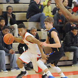 Staff photos by Tom Kelly IV<br /> Coatesville's Keenan Coleman (4) dribbles past West's Sean Loerzel (3) during the Downingtown West at Coatesville boys basketball game on Saturday afternoon January 4, 2014.