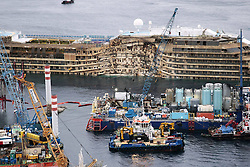 60490190<br /> Isola del Giglio, Italy. <br /> A view of the wreck of Italy's Costa Concordia cruise ship after it emerged from the water on September 17, 2013, near the harbour of Giglio Porto. On 13 January 2012, she was wrecked off the coast of Isola del Giglio in Italy. She has been declared a total loss and is being salvaged as of 2013, following which she will be scrapped, Italy, Tuesday September 17, 2013,<br /> Picture by imago / i-Images<br /> UK ONLY