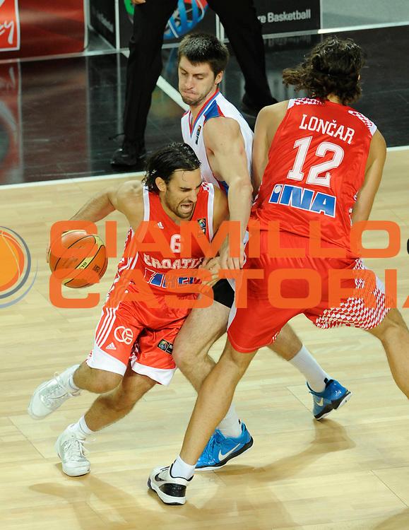 DESCRIZIONE : Istanbul Turchia Turkey Men World Championship 2010 Campionati Mondiali Eight Finals Ottavi Finale Serbia Croatia Croazia<br /> GIOCATORE : Marko POPOVIC<br /> SQUADRA : Croatia Croazia<br /> EVENTO : Istanbul Turchia Turkey Men World Championship 2010 Campionato Mondiale 2010<br /> GARA : Serbia Croatia Croazia<br /> DATA : 04/09/2010<br /> CATEGORIA : Blocco<br /> SPORT : Pallacanestro <br /> AUTORE : Agenzia Ciamillo-Castoria/N.Parausic<br /> Galleria : Turkey World Championship 2010<br /> Fotonotizia : Istanbul Turchia Turkey Men World Championship 2010 Campionati Mondiali Eight Finals Ottavi Finale Serbia Croatia Croazia<br /> Predefinita :
