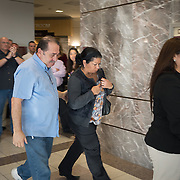 FORT LAUDERDALE, FLORIDA, DECEMBER 21, 2015<br /> Suspended Broward Sheriff's deputy Peter Peraza's, family, from left; parents Gilbert and Elizabeth Peraza and wife Melinda, walk out of a courtroom in the Broward County Courthouse following a brief court appearance. Peraza faces manslaughter charges in the shooting death of Jermaine McBean, 33, in July of 2013.<br /> (Photo by Angel Valentin/Freelance).