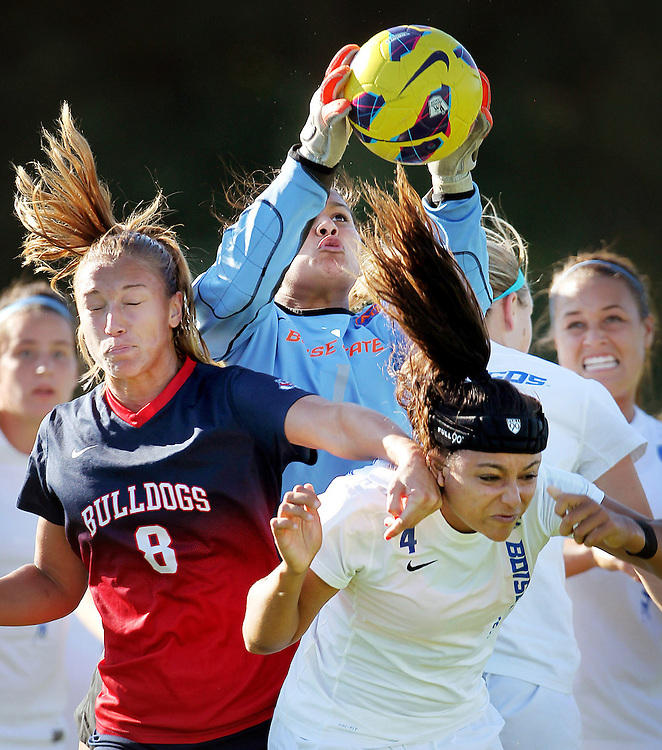 Mikhaila Bowden (right, ponytail) fights for a header with Fresno State player Fanny Johansson (left, 8) during the game at the Boise State soccer complex. Boise State soccer senior Mikhaila Bowden will leave having played more minutes than any player in school history. She also has overcome a heartbreaking tragedy. Her younger sister committed suicide a few months after Bowden left home to play at Boise State. Friday October 10, 2014