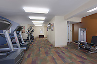Interior image of Courthouse Square Apartments Fitness Center by Jeffrey Sauers of Commercial Photographics