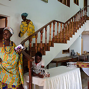 Queen Mothers descending from their rooms at the Institute for Research, Advocacy and Training ahead of a swearing-in ceremony for newly elected members of their council in Accra, Ghana on 23 June 2015. A queen mother is a traditional female leader, drawn from the relevant chiefly lineage, who is responsible for women's and children's issues in particular. Though often widely respected and sometimes powerful, especially in matrilineal ethnic groups, their authority is subject to a male chief. After being suppressed during the colonial era, the role of queen mother is being revived in Ghana and is seen by many as a force for development.
