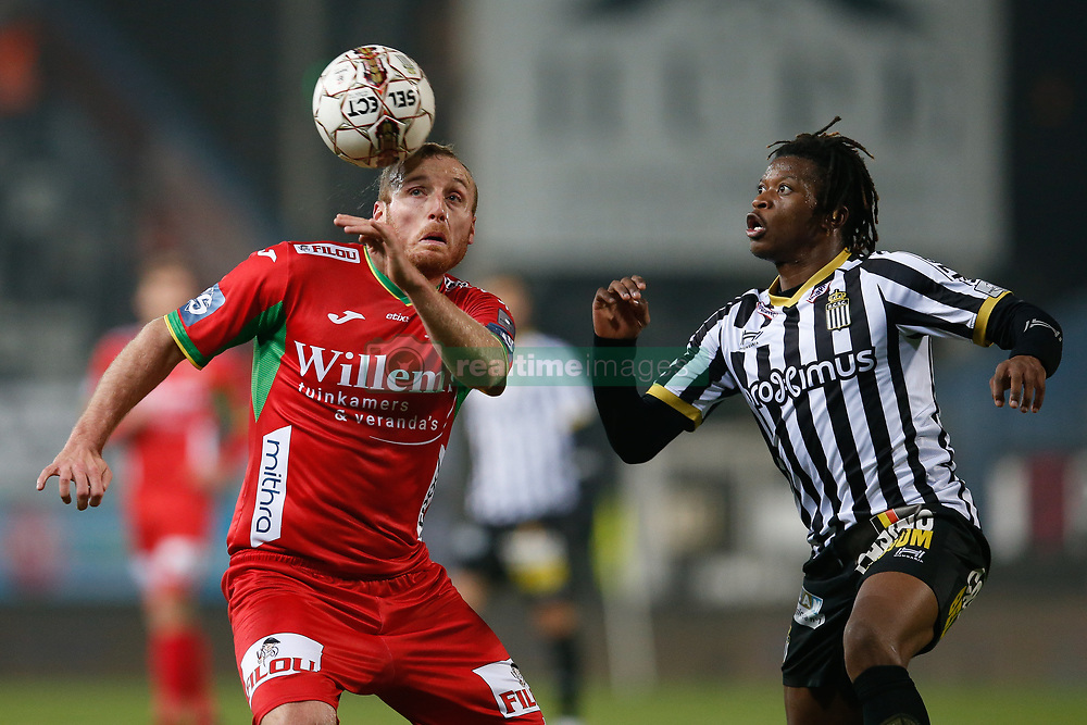 December 1, 2017 - Charleroi, BELGIUM - Oostende's Kevin Vandendriessche and Charleroi's Matias Nurio fight for the ball during the Jupiler Pro League match between Sporting Charleroi and KV Oostende, in Charleroi, Friday 01 December 2017, on the day 17 of the Jupiler Pro League, the Belgian soccer championship season 2017-2018. BELGA PHOTO BRUNO FAHY (Credit Image: © Bruno Fahy/Belga via ZUMA Press)