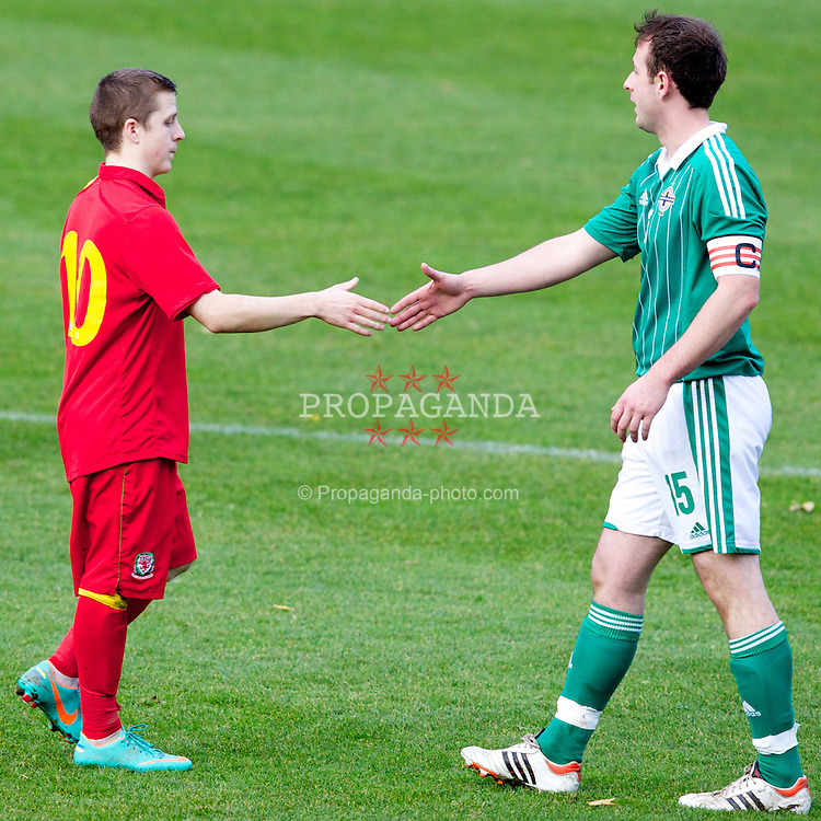 BANGOR, WALES - Thursday, November 8, 2012: Wales' Ryan Hopkins in action against Northern Ireland's captain Iain Dickson after the International Learning Disability Fixture at the Nantporth Stadium. (Pic by Vegard Grott/Propaganda)