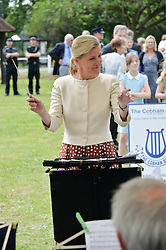 HRH the Countess of Wessex visits the Riverhill Regeneration project in Cobham Surrey on 9th July 2014.<br /> Picture shows:-The COUNTESS OF WESSEX conducts the Cobham Band.