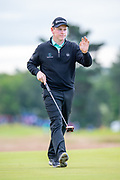 Robert MacIntyre (SCO) acknowledges the crowd after making a birdie on the 11th during the second round of the Aberdeen Standard Investments Scottish Open at The Renaissance Club, North Berwick, Scotland on 12 July 2019.