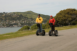Couple on Segways, each on a Segway, on Angel Island State Park in San Francisco Bay, California, CA. Model released..Photo camari207-70408..Photo copyright Lee Foster, www.fostertravel.com, 510-549-2202, lee@fostertravel.com.