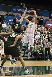 08 March 2014:  Pat Sodemann shoots a hanging fade while challenged by Austin Elliott during an NCAA mens division 3 2nd Round Playoff basketball game between the St Norbert Green Knights and the Illinois Wesleyan Titans in Shirk Center, Bloomington IL