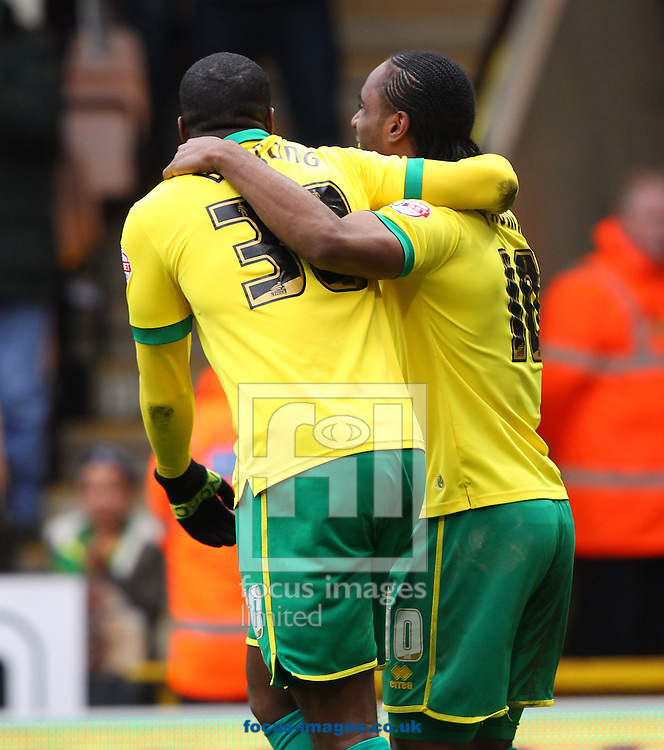 Cameron Jerome of Norwich celebrates scoring his sides 2nd goal  during the Sky Bet Championship match at Carrow Road, Norwich<br /> Picture by Paul Chesterton/Focus Images Ltd +44 7904 640267<br /> 21/03/2015