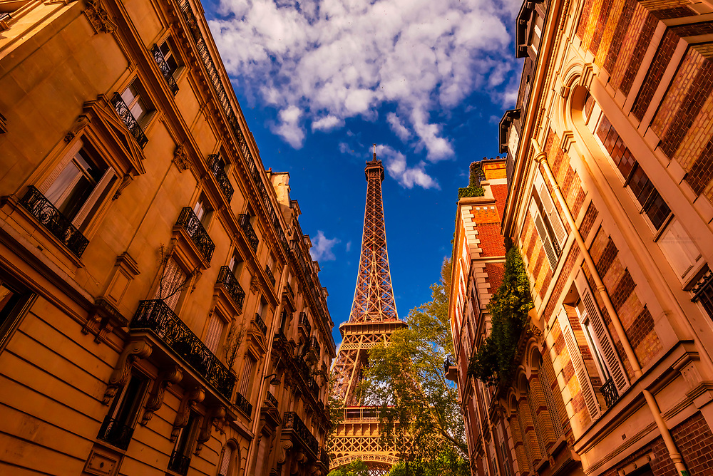 Eiffel Tower seen from Rue de l'Universite, Paris, France.