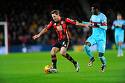 AFC Bournemouth midfielder Dan Gosling and West Ham Utd midfielder Pedro Mba Obiang during the Barclays Premier League match between Bournemouth and West Ham United at the Goldsands Stadium, Bournemouth, England on 12 January 2016. Photo by Graham Hunt.