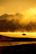 Golden Morning on Lake Dillon with single sailboat-vertical