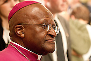Archbishop Desmond Tutu. Princess Charlene of Monaco visits Cape Town for a day to visit charities for which she is a co-patron with Archbishop Desmond Tutu who joined her. Image by Greg Beadle Portraits captured by Greg Beadle in studio and on location