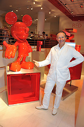 NICK ASHLEY at an exhibition at The Conran Shop entitled Red to celebrate 25 years of The Conran Shop at the Michelin Building, 81 Fulham Road, London on 19th September 2012.