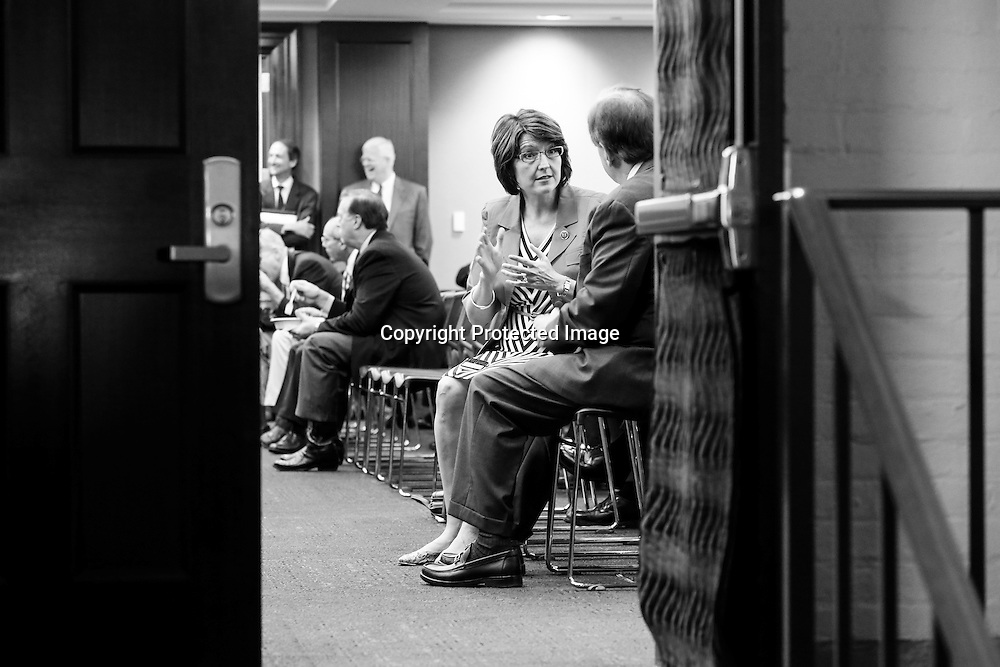 U.S. Representative Cathy McMorris Rodgers (R-WA) (C), the House Republican Conference Chair, talks with fellow members as they arrive for a closed-door meeting of the House Republican caucus during a rare Saturday session at the U.S. Capitol in Washington, September 28, 2013. With conservative House Republicans promising not to back down on an emergency spending bill in a push to defund President Barack Obama's healthcare reform law, the U.S. government edged closer on Saturday to its first shutdown since 1996.