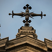 Cross at the top of the Church of Saint John the Baptist at the Béguinage, 17th century Flemish Baroque style Roman Catholic Church in central Brussels, Belgium. It was originally part of the beguinage Notre-Dame de la Vigne.