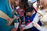 Korean Folk Village. TV movie set. Kids getting autographs from famous TV actor Kim Ho-Kun.