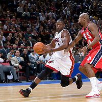 9 October 2008: Dwyane Wade of the Miami Heat drives past Trenton Hassell of the New Jersey Nets during the New Jersey Nets 100-98 overtime victory over the Miami Heat in an exhibition game at Bercy Arena, in Paris, France.