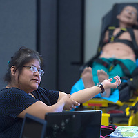 Michelle Nez demonstrates a hinge join during the EMS course at the University of New Mexico branch in Gallup Thursday.