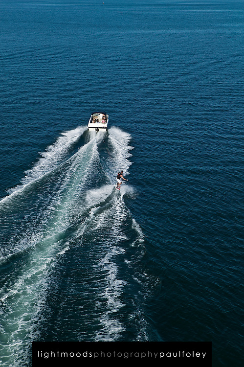 Aerial view of family waterskiing (wakeboarding) on Lake Macquarie, East Coast Australia