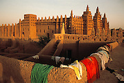 Clothes dry on the mud walls on rooftops of homes facing the Grand Mosque of Djenne, Mali.