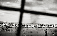 """Dollo Ado, Ethiopia.October2011<br /> I the """"Kobe"""" refugeecamp, more than 25.000 people are living. Due to the open, dry area - the camp is daily hit by large dust storms, that makes living there even more difficult than it already is. <br /> """" The drought in the horn of Africa is affecting more than 4.5 million people in Ethiopia. In addition, more than 140.000 refugees from Somalia have settled in camps in the border region between Somalia and Ethiopia. In the area around the border city Dollo Ado, four large refugee camps are already over crowded. A fifth camp is under construction due to the big influx still taking place. Many of the refugees are children, arriving severely malnutritioned. The mortality rate among small children has been brought down, but still children are dying on a daily basis...<br /> The four camps –Hilaweyn,Kobe, Malkadida and Bokomayo are now hosting more than 120.000 refugees and more are coming daily.... Somalia. AAfter more than two decades of war, Somalia is slowly trying to rebuild itself. hounded thousands of IDP´s are still living in and around the country with little to no chance of returning soon. corruption, religion and constant threat of warlords are still present in the country. Somalia. AAfter more than two decades of war, Somalia is slowly trying to rebuild itself. hounded thousands of IDP´s are still living in and around the country with little to no chance of returning soon. corruption, religion and constant threat of warlords are still present in the country. Somalia. AAfter more than two decades of war, Somalia is slowly trying to rebuild itself. hounded thousands of IDP´s are still living in and around the country with little to no chance of returning soon. corruption, religion and constant threat of warlords are still present in the country. Somalia. AAfter more than two decades of war, Somalia is slowly trying to rebuild itself. hounded thousands of IDP´s are still living in and around the country. Somalia."""