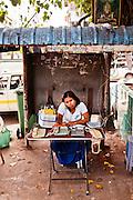 Per-minute telephone call booth. Yangon, Myanmar.