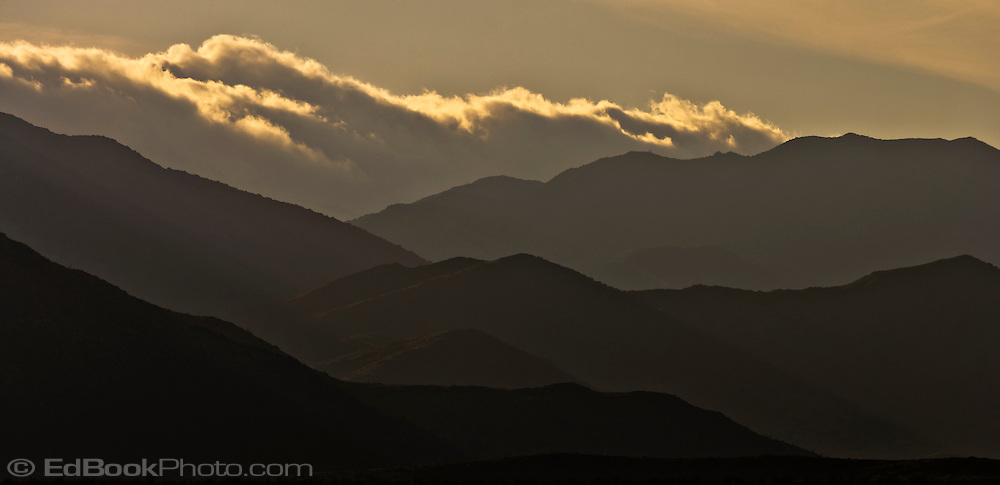 the Santa Inez mountain ridges silhouetted in evening light in the Anza-Borrego Desert state Park, Borrego Springs, California, USA panorama