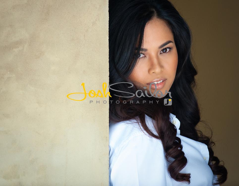 Model Lin Laishram leaning back on sandstone wall