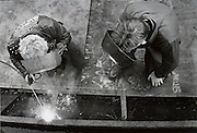 Two men welding