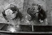 Two men welding