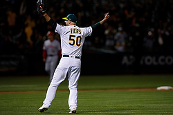 OAKLAND, CA - MAY 07: Mike Fiers #50 of the Oakland Athletics celebrates after pitching a no hitter against the Cincinnati Reds at the Oakland Coliseum on May 7, 2019 in Oakland, California. The Oakland Athletics defeated the Cincinnati Reds 2-0. (Photo by Jason O. Watson/Getty Images) *** Local Caption *** Mike Fiers