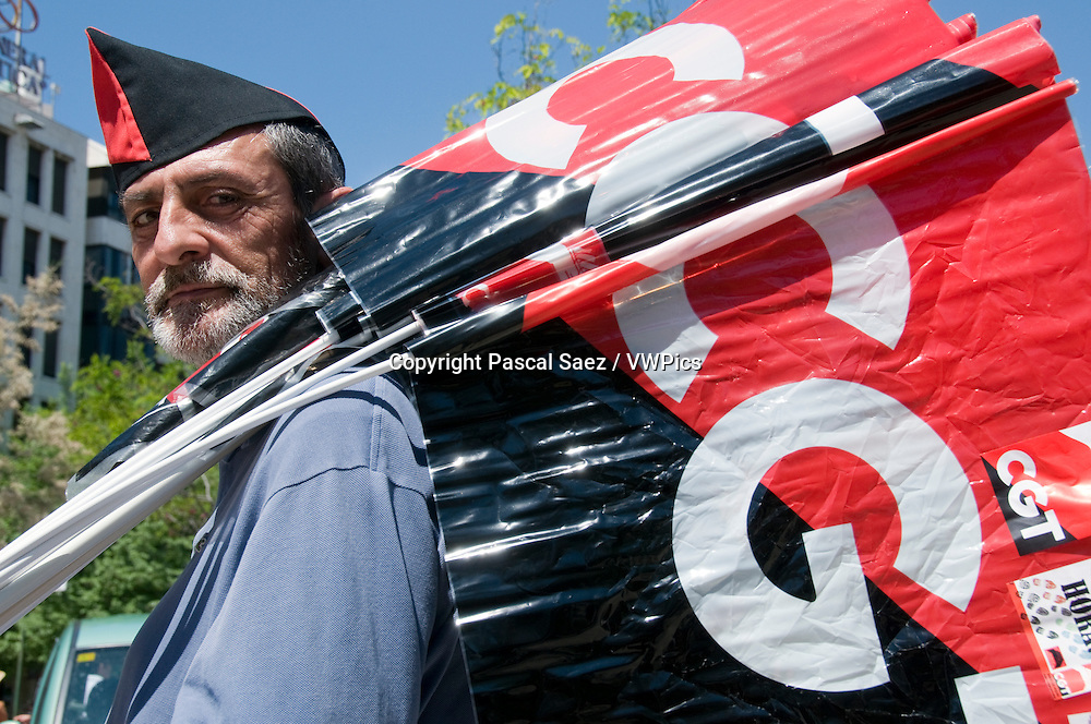 1st May 2010 - Granada, Spain - A member of the CGT (Confederaci&oacute;n General  del Trabajo, or General Confederation of Labour in its English translation) trade union poses with CGT flags during the May Day march, an event held worldwide every 1st of May to celebrate workers and workers' rights.<br />