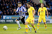 \m15\ plays the ball back dangerously as Sheffield Wednesday forward Gary Hooper (14) watches on during the Sky Bet Championship match between Sheffield Wednesday and Milton Keynes Dons at Hillsborough, Sheffield, England on 19 April 2016. Photo by Simon Davies.