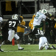 Marshall running back Tron Martinez (2) leaps Central Florida defensive back A.J. Bouye (19)during an NCAA football game between the Marshall Thundering Herd and the Central Florida Knights at Bright House Networks Stadium on Saturday, October 8, 2011 in Orlando, Florida. (Photo/Alex Menendez)