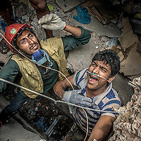Mobarak Hossain (left), originally from Kishoreganj, happened to be nearby the Rana Plaza building when hearing news of the collapse. He worked as a volunteer for more than a month after the building had been destroyed to rescue victims from the rubble as well as provide relief.