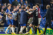 John Terry, Assistant Head Coach of Aston Villa FC retrains Neal Maupay (Brighton) following the altercation between Neal Maupay (Brighton) & Ezri Konsa (Aston Villa) as both players went to leave the pitch following the final whistle after the Premier League match between Brighton and Hove Albion and Aston Villa at the American Express Community Stadium, Brighton and Hove, England on 18 January 2020.