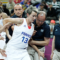 07 August 2012: France Elodie Godin looks injured at the back during 71-68 Team France victory over Team Czech Republic, during the women's basketball quarter-finals, at the Basketball Arena, in London, Great Britain.